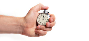 Man's hand holding stopwatch